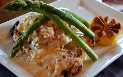 chicken breast topped with lump crab meat. Chicken Oscar